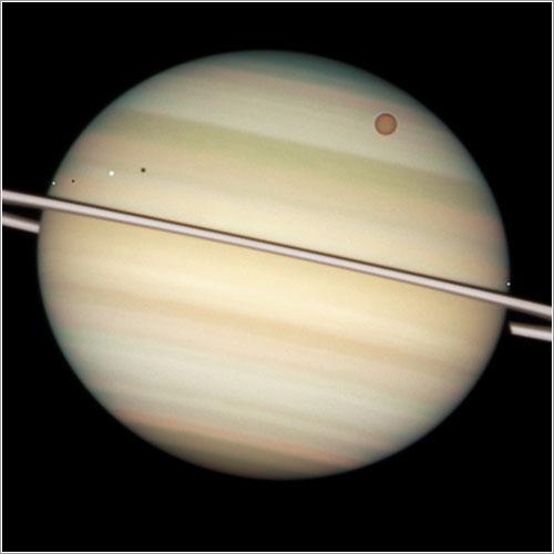 Saturno y cuatro de sus lunas - NASA, ESA, Hubble Heritage Team