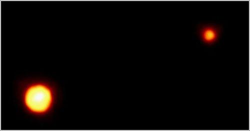Plutón y Caronte - Dr. R. Albrecht, ESA/ESO Space Telescope European Coordinating Facility; NASA